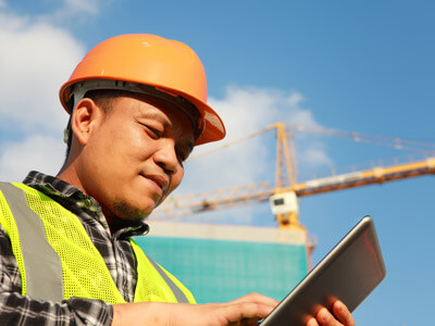 Man using building permit software