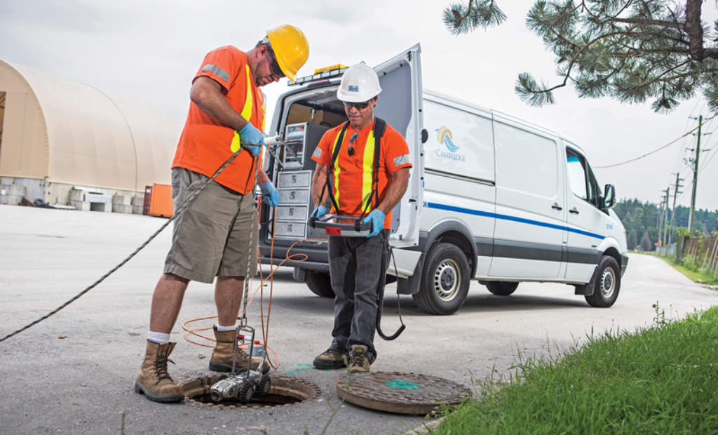 Workers checking out a sewer